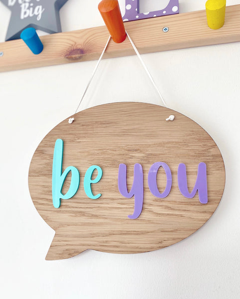 wooden hanging plaque in the shape of a speech bubble with be cool in mint green and lilac acrylic
