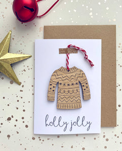 Christmas card with a wooden christmas jumper decoration on the front