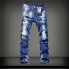 Load image into Gallery viewer, Distressed Mid-Rise Jeans
