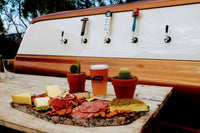 A nice spread of cheese, crackers and meats at this mobile bar to pair with your craft beers.