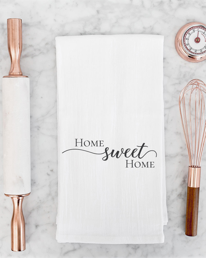 The Home sweet home tea towel is perfect for those of us who love the comfort of a cozy home. Display it in the kitchen to make your space extra welcoming.