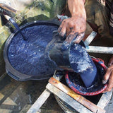 Deep blue indigo natural dye being filtered in North Java, Indonesia