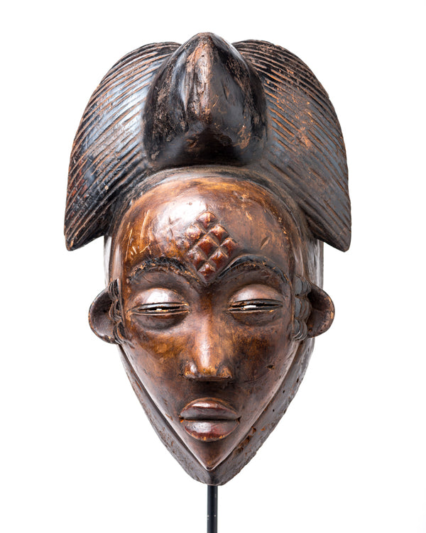 Punu mask with dark face