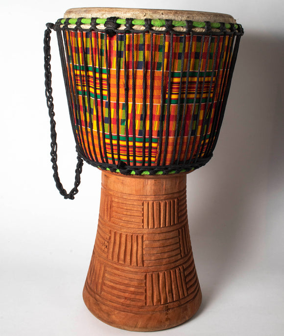 Drum with textile decoration