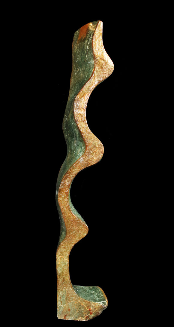 Green and rust stone sculpture