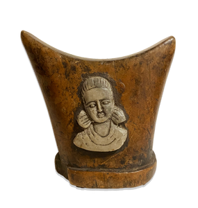 headrest with female figure
