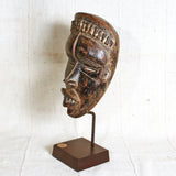 Realistic mask hand carved from one piece of wood