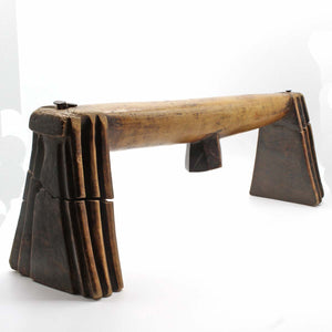 long old wooden headrest with high patina