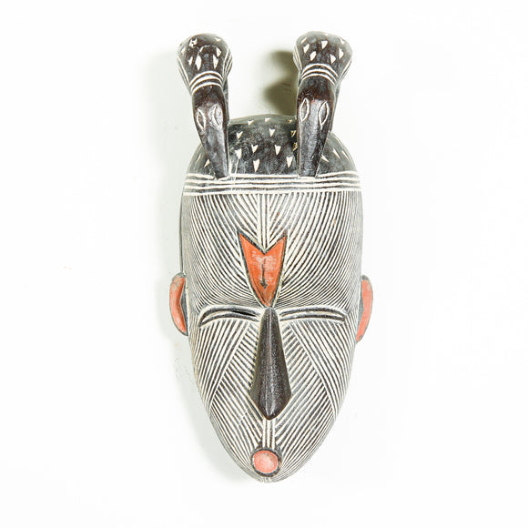 African mask with birds