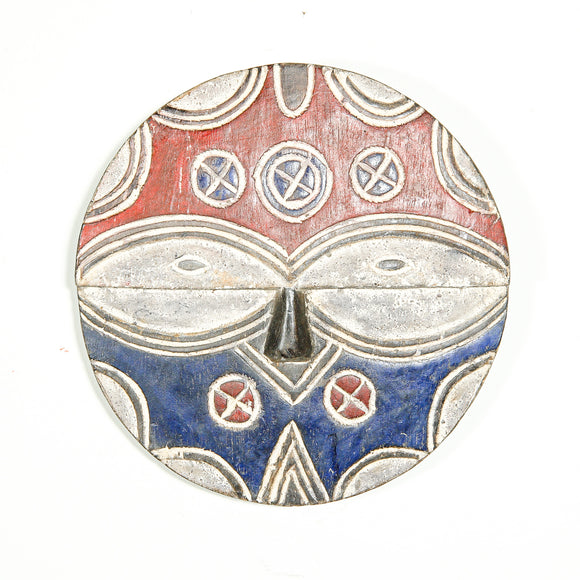 red and blue Teke mask