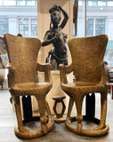 Pair of gold thrones with Shona sculpture