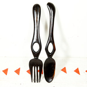 Salad tongs in dark wood