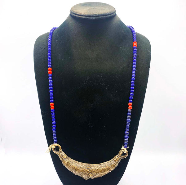 Metal antique jewelry from Africa with blue beaded chain