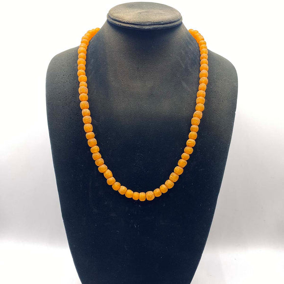 Orange sustainable glass jewelry from Ghana