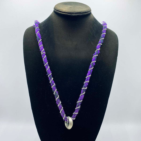 Ethiopian wedding ring worn on a purple necklace