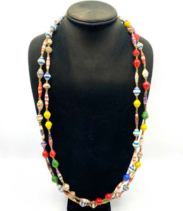 Woman made necklace with paper beads from Africa