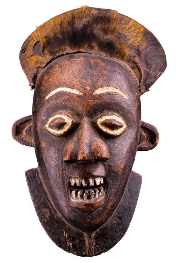 The Bamum live in northwestern Cameroon. The Bamum masks were worn on top of the head instead of over the face. They were brought out for a ceremony at the first rainfall.