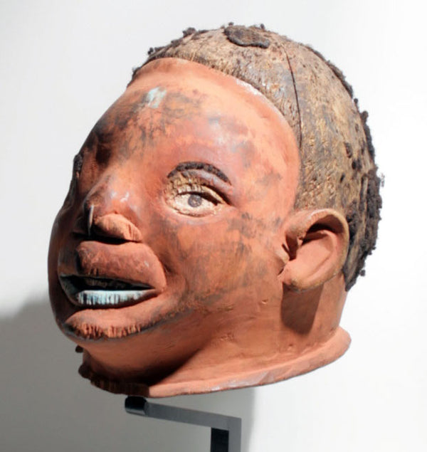 Makonde mask with reddish face