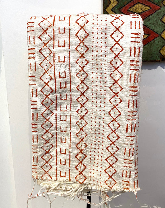 White and orange African cotton fabric
