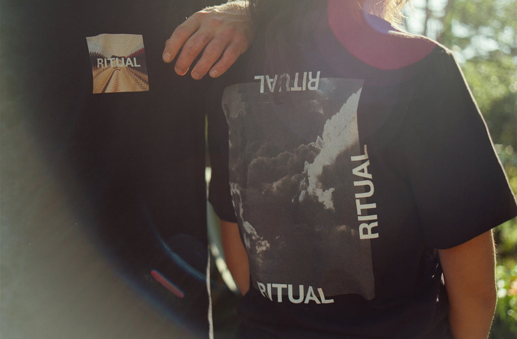 Male and female models wearing streetwear brand Meaningless Ritual, one featuring a psychedelic repeating vintage image of a Japanese woman superimposed with the word RITUAL and a backprint of repeating monochrome storm clouds bordered by the word RITUAL