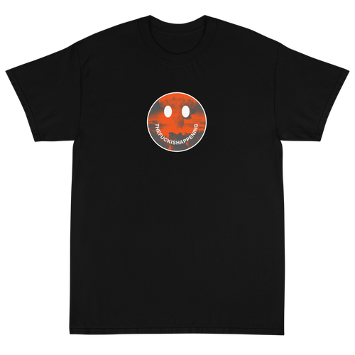 Dark humor apocalypse t-shirt smile face with the words the fuck is happening, an atomic explosion in the background