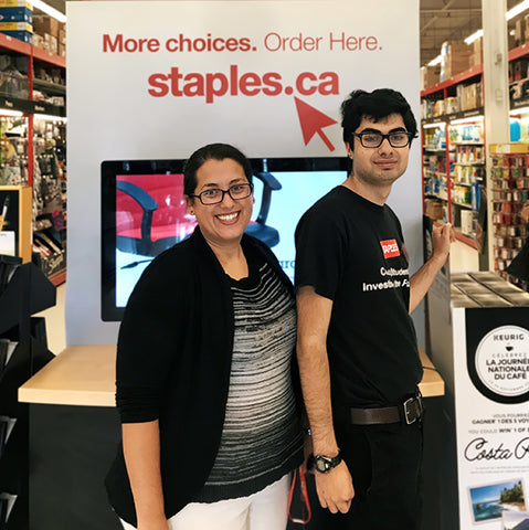 New Haven Team Member with client smiling to take a picture at Staples