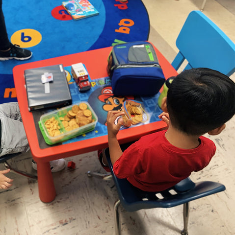 Children eating on a children's table