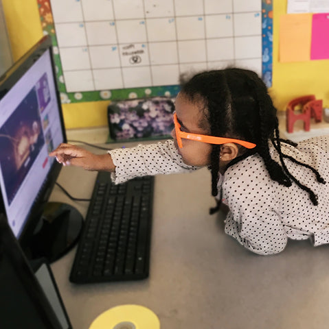 Young girl interacting with computer