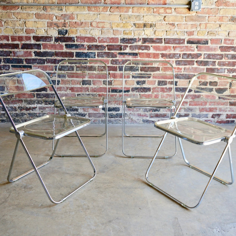 """Plia"" clear acrylic folding chairs by Giancarlo Piretti for Castelli"
