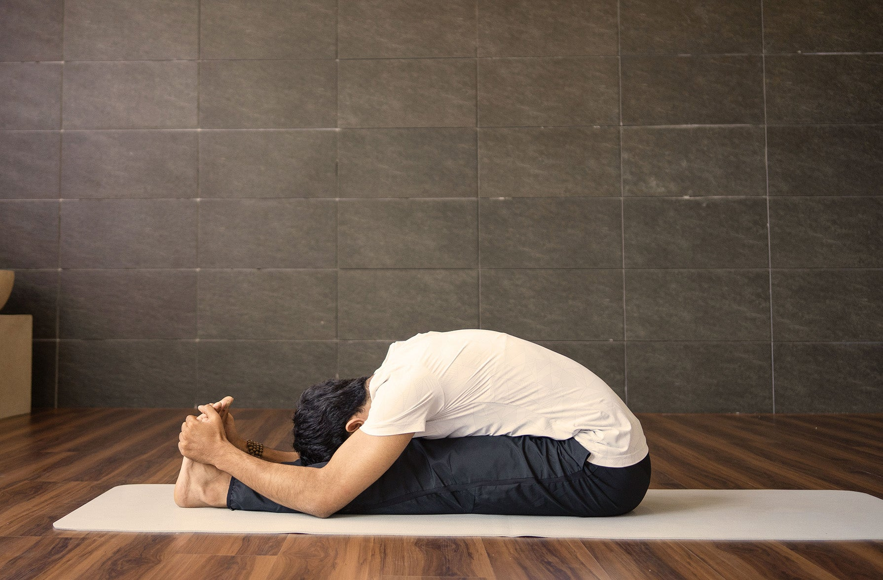 Paschimottanasana pose (yoga pose for upper back pain)