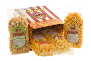Campbell's Famous Popcorn Best Selling Combinationwith Dichotomy, Caramel, Cheddar, Butter with  4 Flavor Box. Popped fresh and delivered fast in gift tins, bags, and boxes. Visit www.campbellsfamouspopcorn.com. Side view with bags