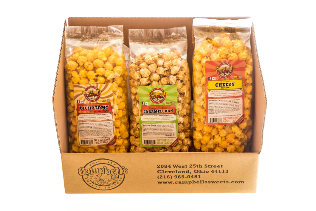 Campbell's Famous Popcorn Everyone's Favorite Trio with Dichotomy, Caramel, Cheddar with 3 Flavor Box. Popped fresh and delivered fast in gift tins, bags, and boxes. Visit www.campbellsfamouspopcorn.com. Box front