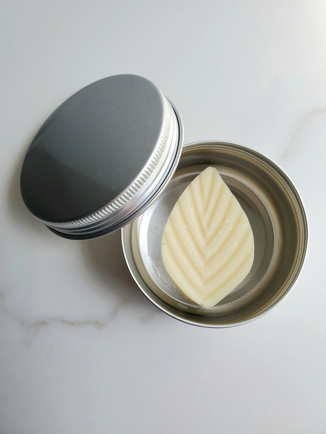 Solid lotion bar w/ tin