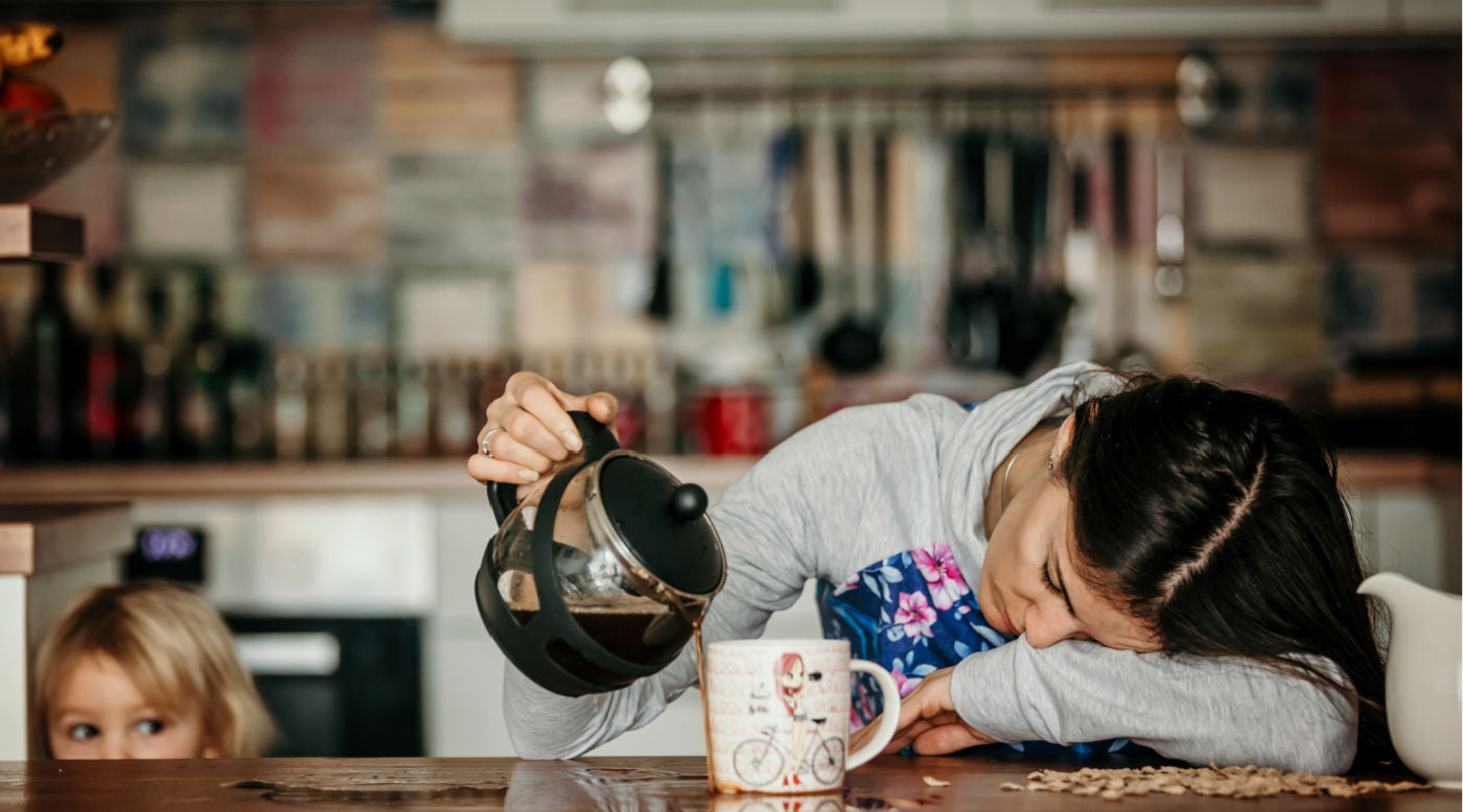 Exhausted mother pouring coffee