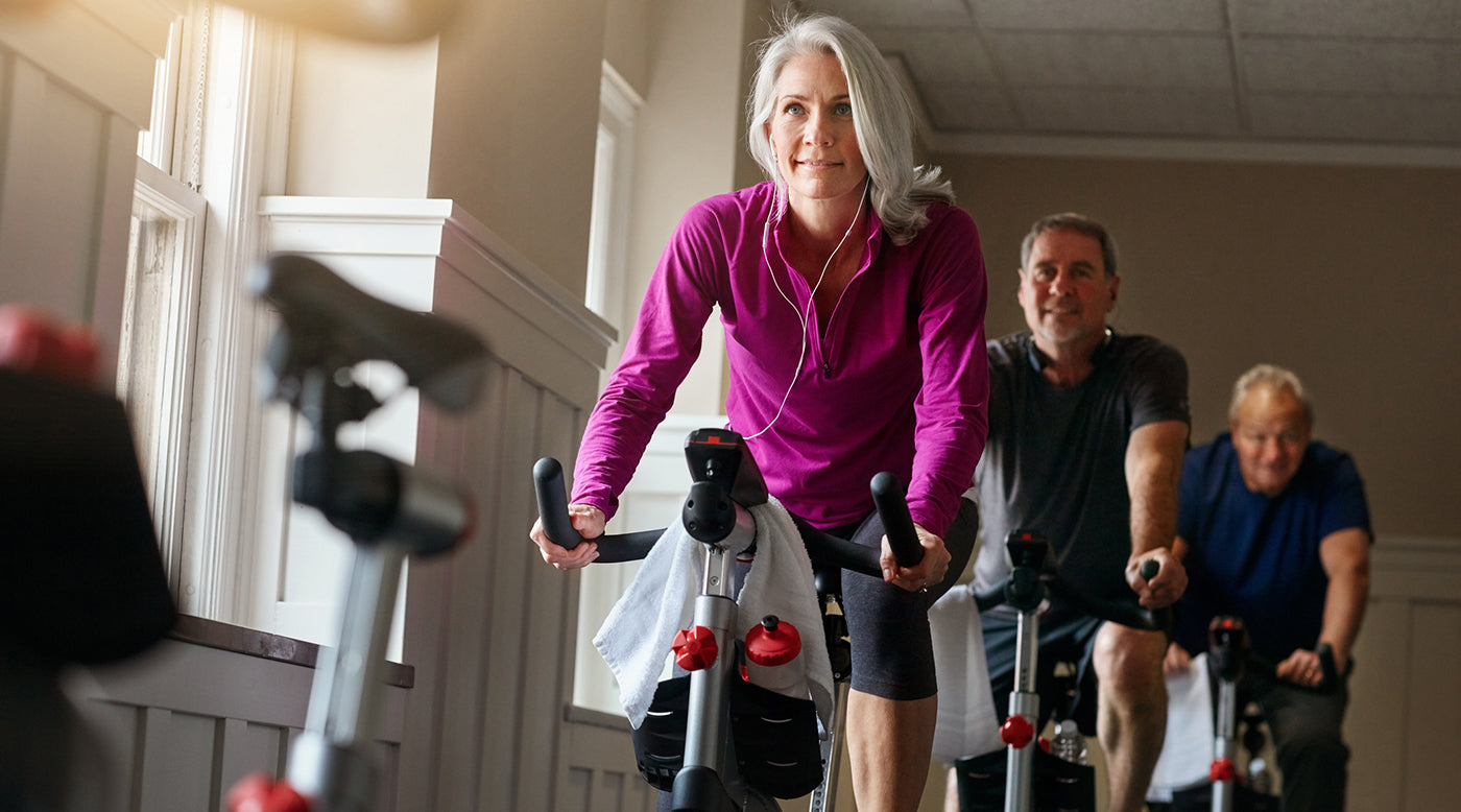 middle-aged people in spin class charging up their immune system