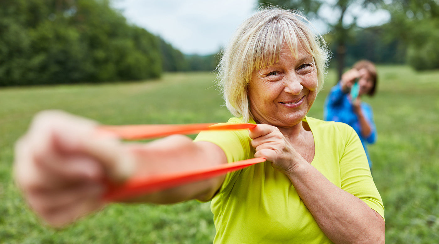 senior woman using exercise bands