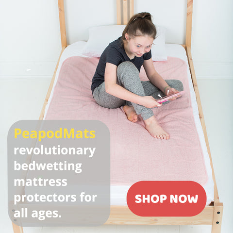 Girl sitting on the bed covered with PeadpodMat