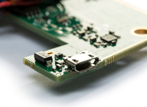 Close up showing USB connector on bare circuit board version of CAN bus interface and data logger