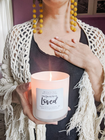 holding a lit loved affirmation candle with heart opening | Mining for Soul