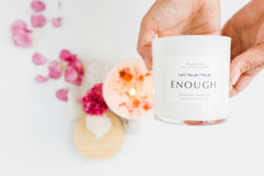 enough affirmation candle being held up