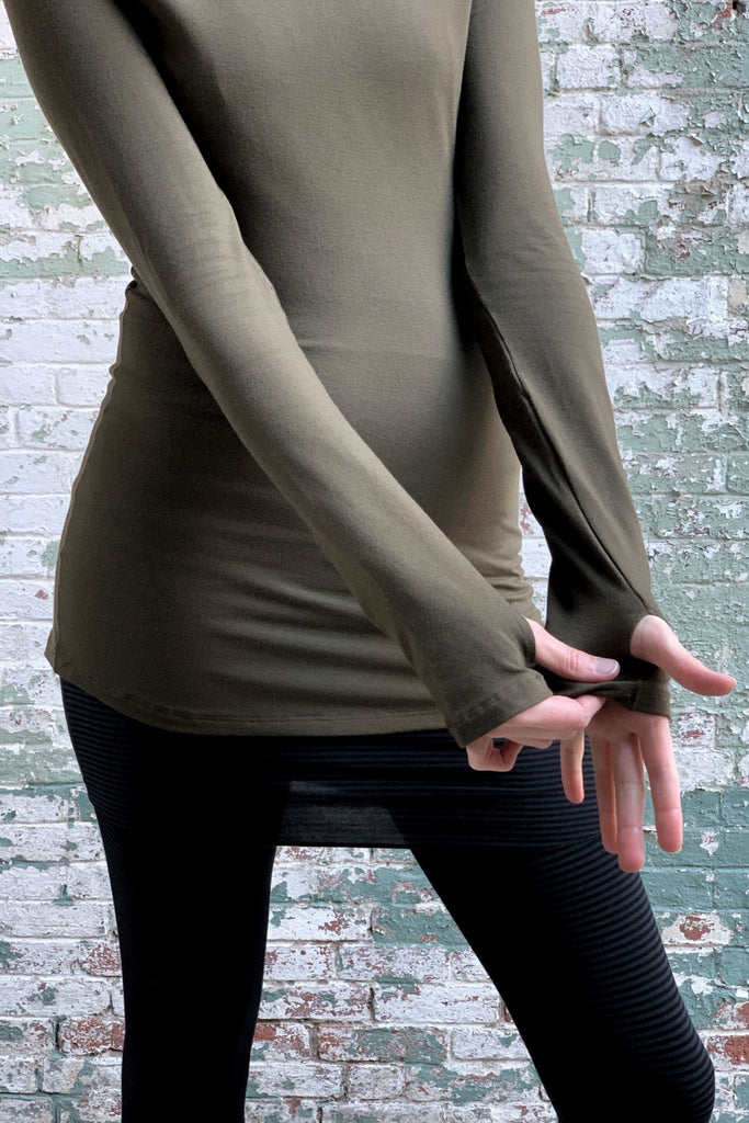neck in olive - thumb slits allow warmth + comfort