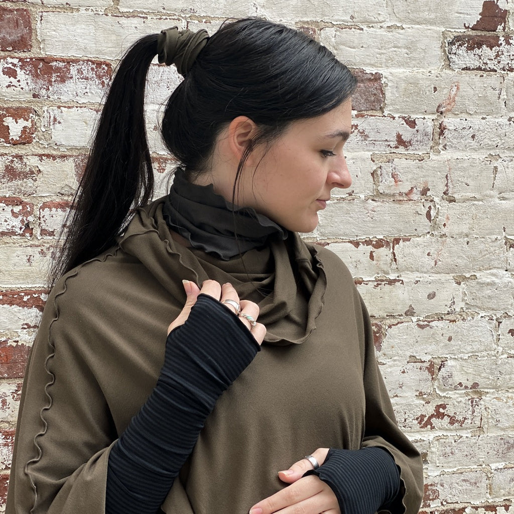 olive flirt as a poncho with our subtle black stripe opera sleeves