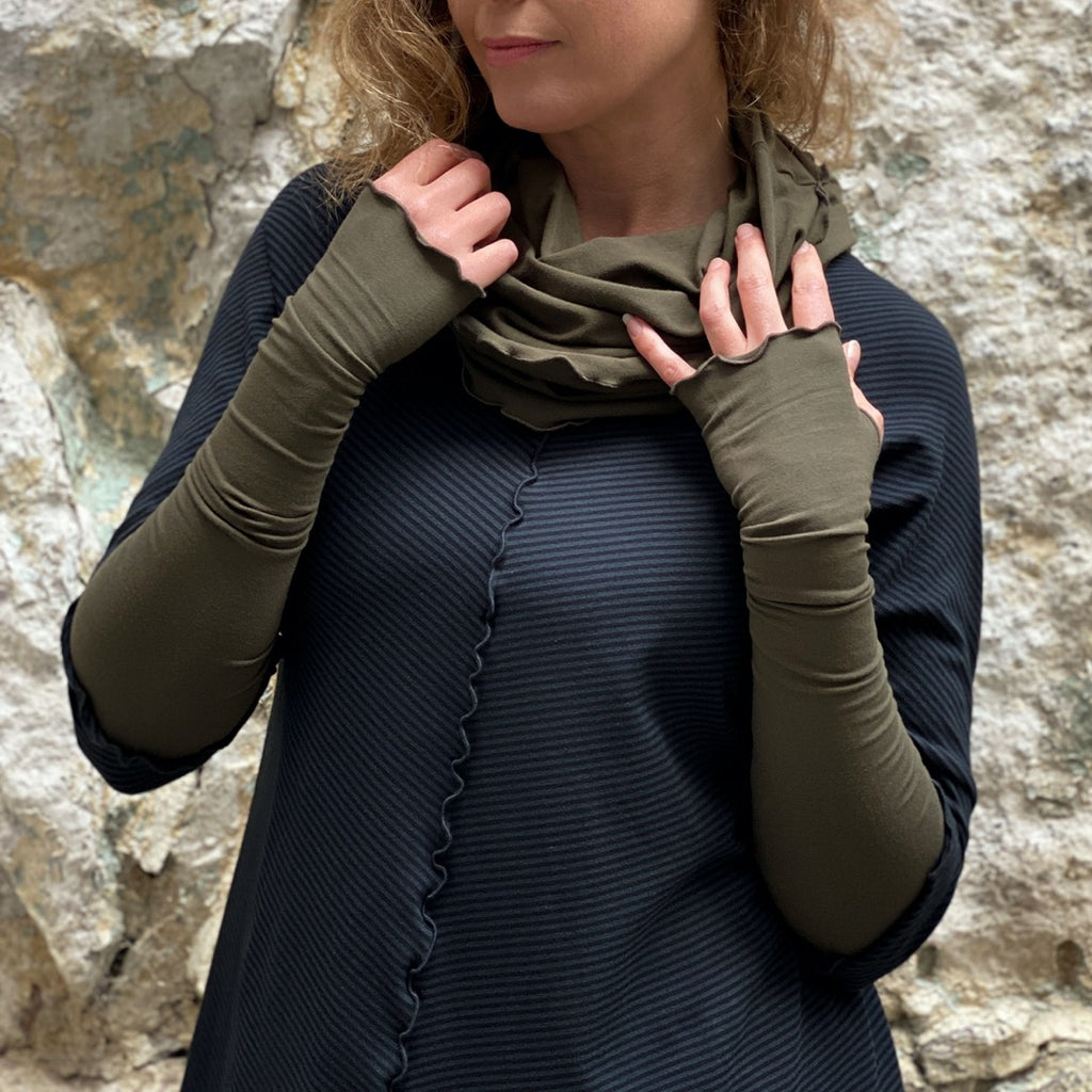 olive opera sleeves and hourglass cowl complement subtle black swing tunic