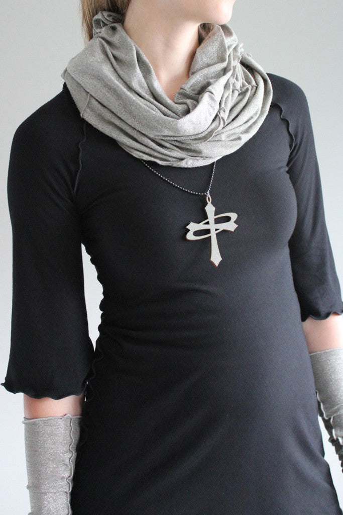black ballet tunic by angelrox with pewter shimmer hourglass and opera sleeves. the angelrox logo represents balance