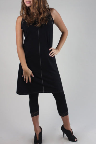 black suger shift dress with tan stitching