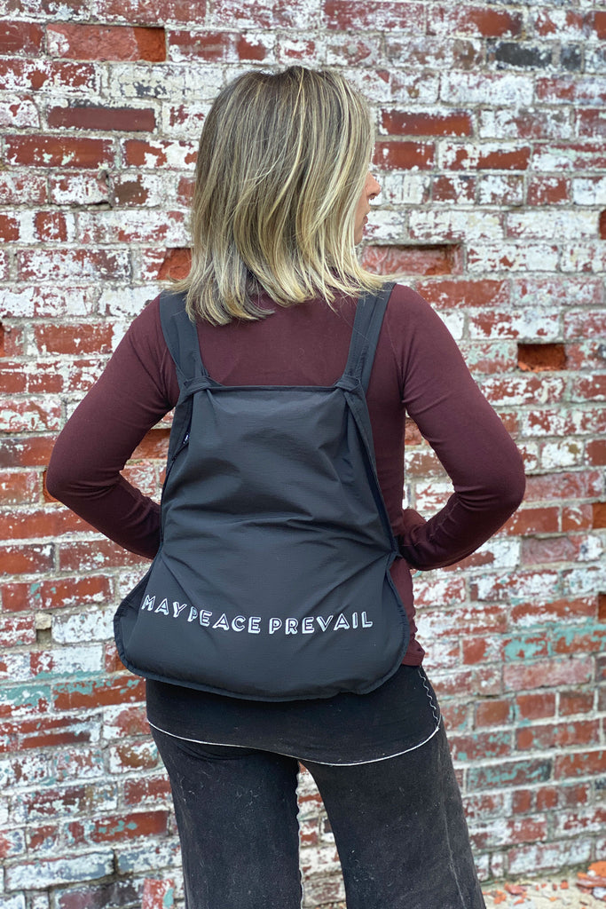 may peace prevail tote backback