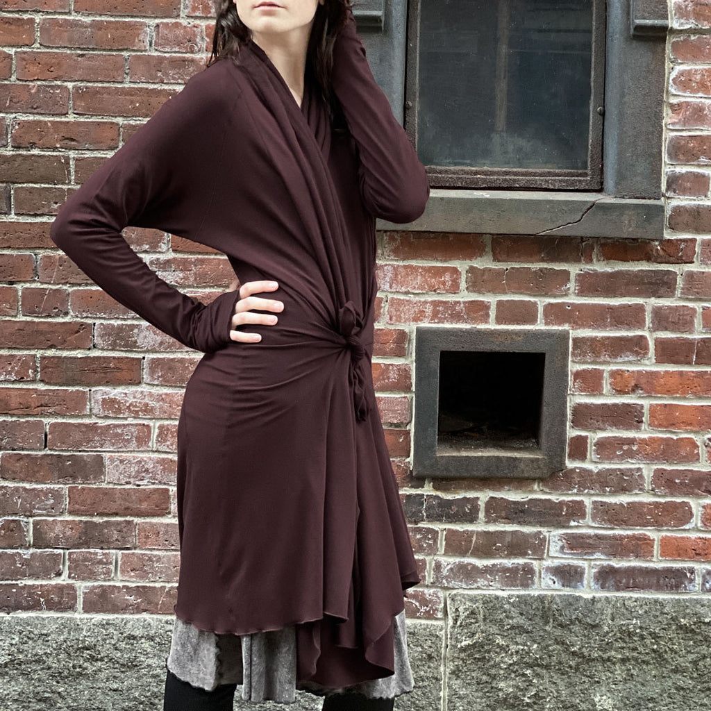 riding coat in wine tied at the waist with versatile pockets