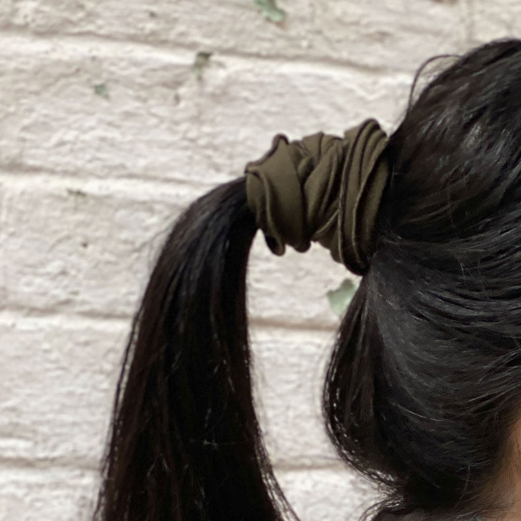 olive band holds ponytail securely