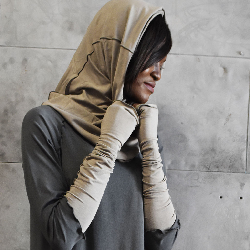 clay opera sleeves and hourglass hooded cowl are simply elegant paired with iron swing tunic