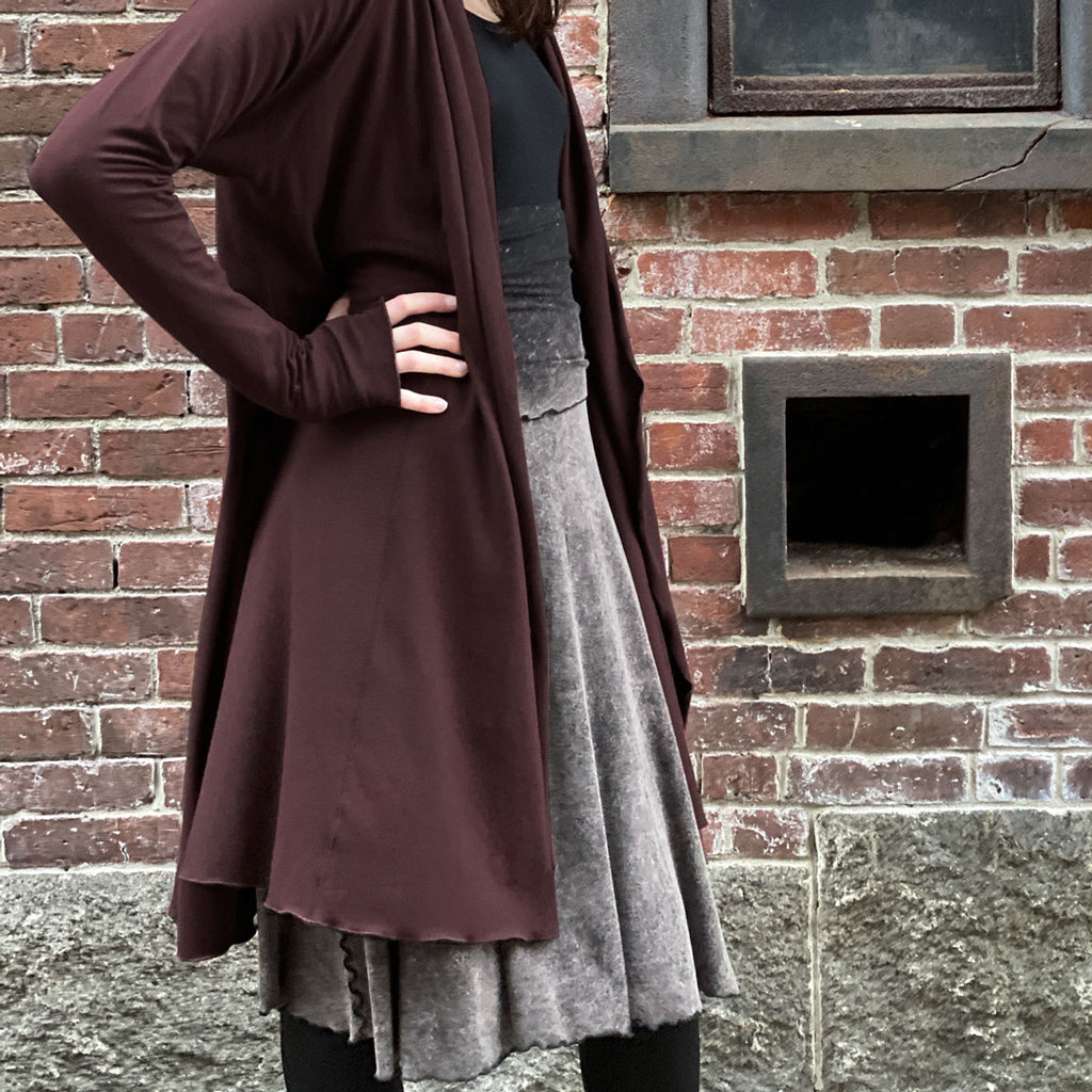 mineral lady flirt worn as skirt with black core tank + wine riding coat